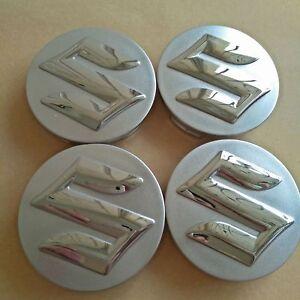 SUZUKI-4x-54mm-Silber-Felgendeckel-Emblem-Radmitte-Nabenkappen