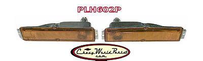 PARK LAMP BEZELS; LH//RH PAIR 63-64 CHEVY II//NOVA