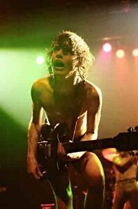 12-034-8-034-colour-concert-photo-of-Angus-Young-of-AC-DC-at-Coventry-in-1978
