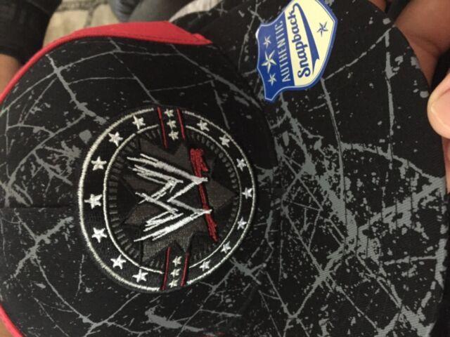 9d80129b WWE World Wrestling Entertainment Snapback Hat Black Red EUC Paint Splatter