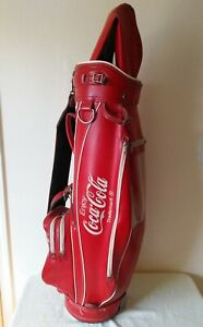 Vintage-Miller-cart-carry-golf-bag-with-Coca-Cola-logo-has-original-rain-cover