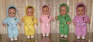 1930-039-s-12-034-MADAME-ALEXANDER-DIONNE-QUINTUPLET-COMPOSITION-DOLLS-IN-SNOW-SUITS