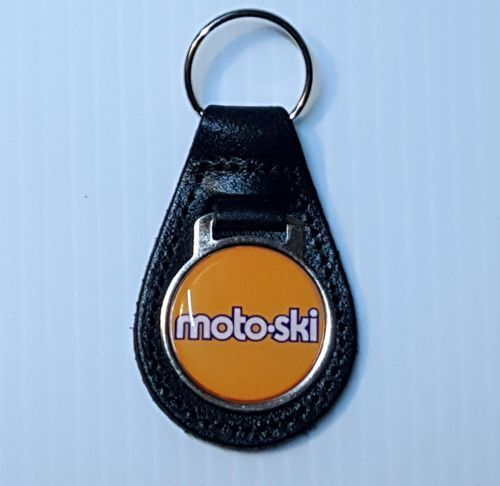 Reproduction Vintage MotoSki Words White Snowmobile Medallion Leather Keychain