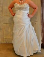 Used wedding dress size 18 with few alterations done to it.