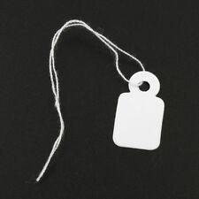 EE825= 1000 Hängeetiketten 25x39mm weiß mit Faden zu je 100 Stk gebunden Karton