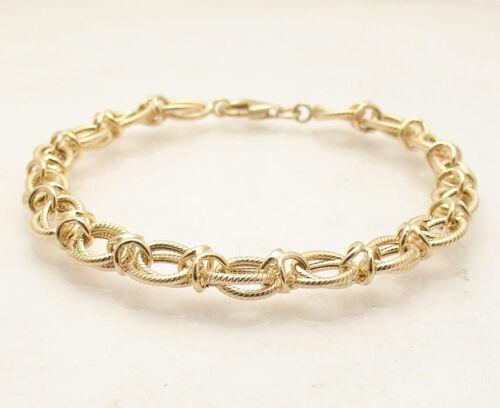 Technibond Textured Interlocked XOXO Bracelet 14K Yellow Gold Clad Silver