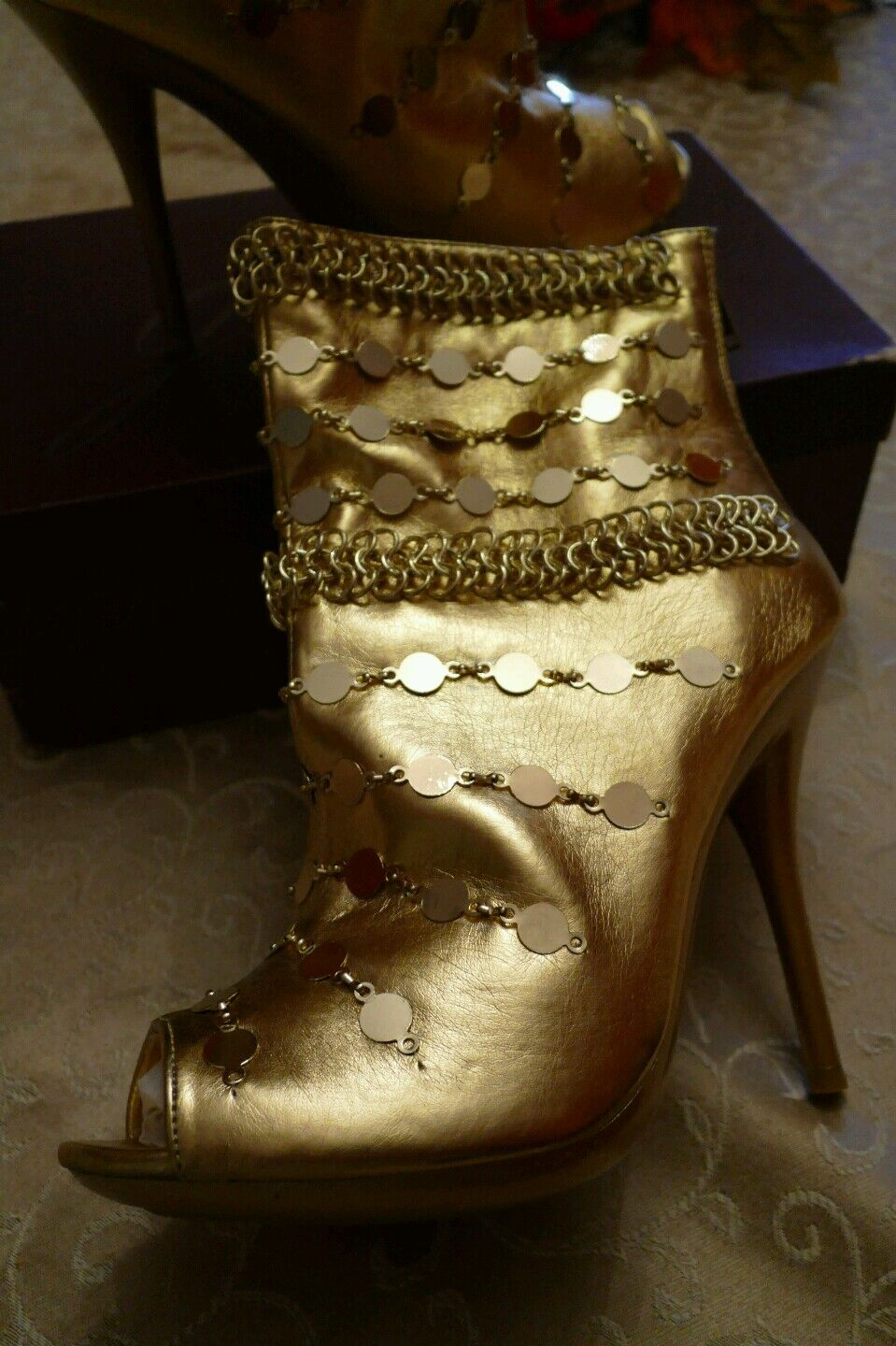 CNNWHOLESALE DEAL,,,,,, gold  mid calf boots five pairs.size 6 1 2m TO 81 2