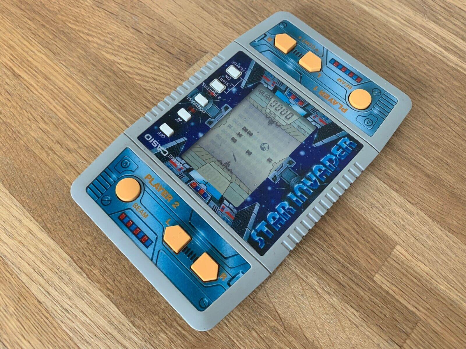 barato y de alta calidad Rare Rare Rare casio esta Estrella Invader 1986 Vintage LCD Portátil Juego Electrónico-Excelente Cond.  marca