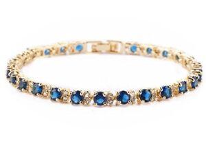 Yellow-gold-finish-Blue-Sapphire-and-created-diamonds-round-cut-tennis-bracelet