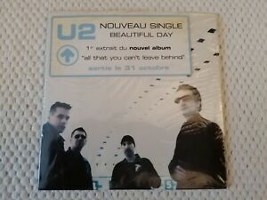 CD-2-TITRES-SINGLE-U2-BEAUTIFUL-DAY-SUMMER-RAIN-FRANCE-2000-STICKER-BLISTER