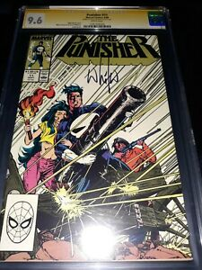 Punisher-11-CGC-SS-9-6-NM-1988-signed-by-Wilce-Portacio-White-Pages