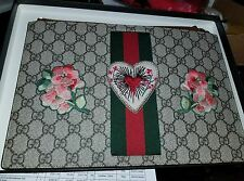 gucci embroidered supreme clutch bag