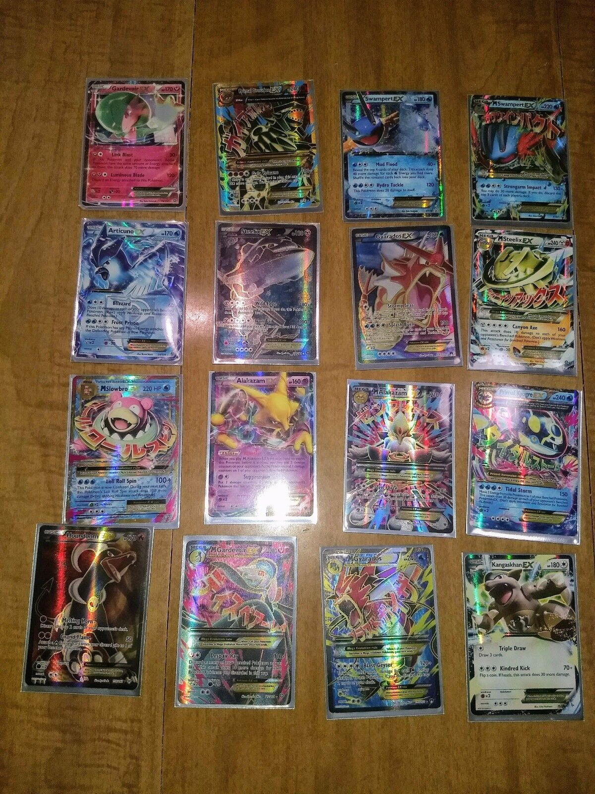 Pokemon card lot of 16 including EXs, Mega, full art, and ultra rares. Mint.