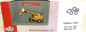 LIEBHERR-L300-excavatrice-pelle-sur-pneus-JAUNE-NZG-565-metal-Collection-H0-1