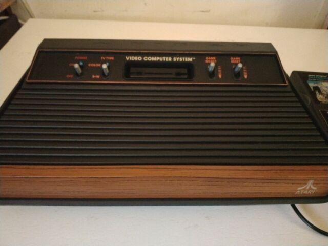 Atari 2600 Launch Edition Woodgrain Console (NTSC) 4 SWITCH CONSOLE AND 2GAMES