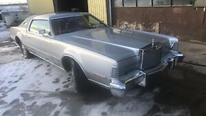 1975 Lincoln Continental silver ext and red interior
