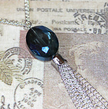 Flapper/1920's style long silver necklace with blue crystal pendant and tassel