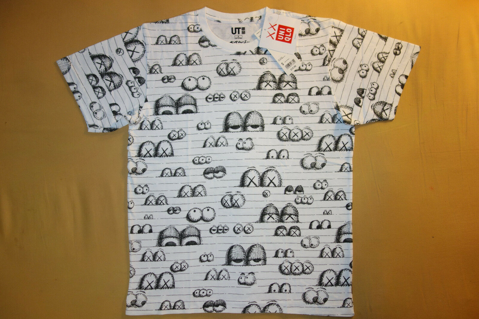 Kaws x Uniqlo UT 2016 Short Sleeve Graphic T-Shirt  Notebook Eyes  White