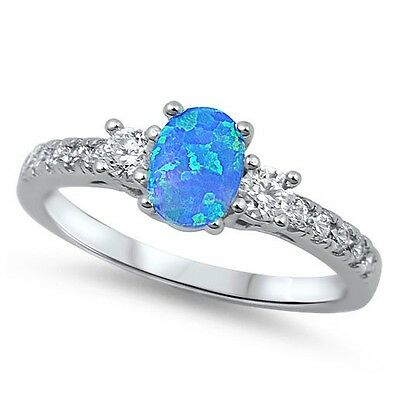 .925 Sterling Silver Simulated Blue Opal Clear CZ Fashion Ring Size 4 - 12