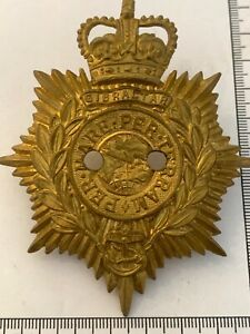 POST 1953 British Army - Royal Marines Officers Pith Helmet badge - with holes ?