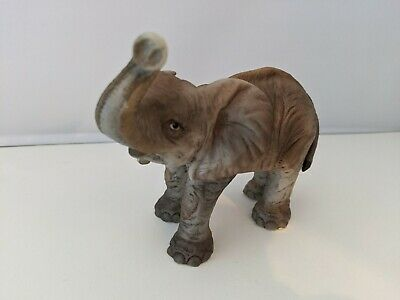 unique find! One is a pin cushion Enesco sticker on bottom of one Vintage elephant figurines