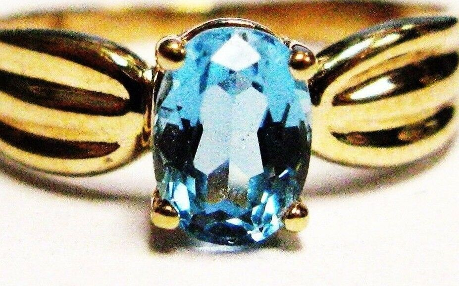 14K Yellow gold Genuine Solitaire Oval bluee Topaz Accent Design Ring Size 7.00