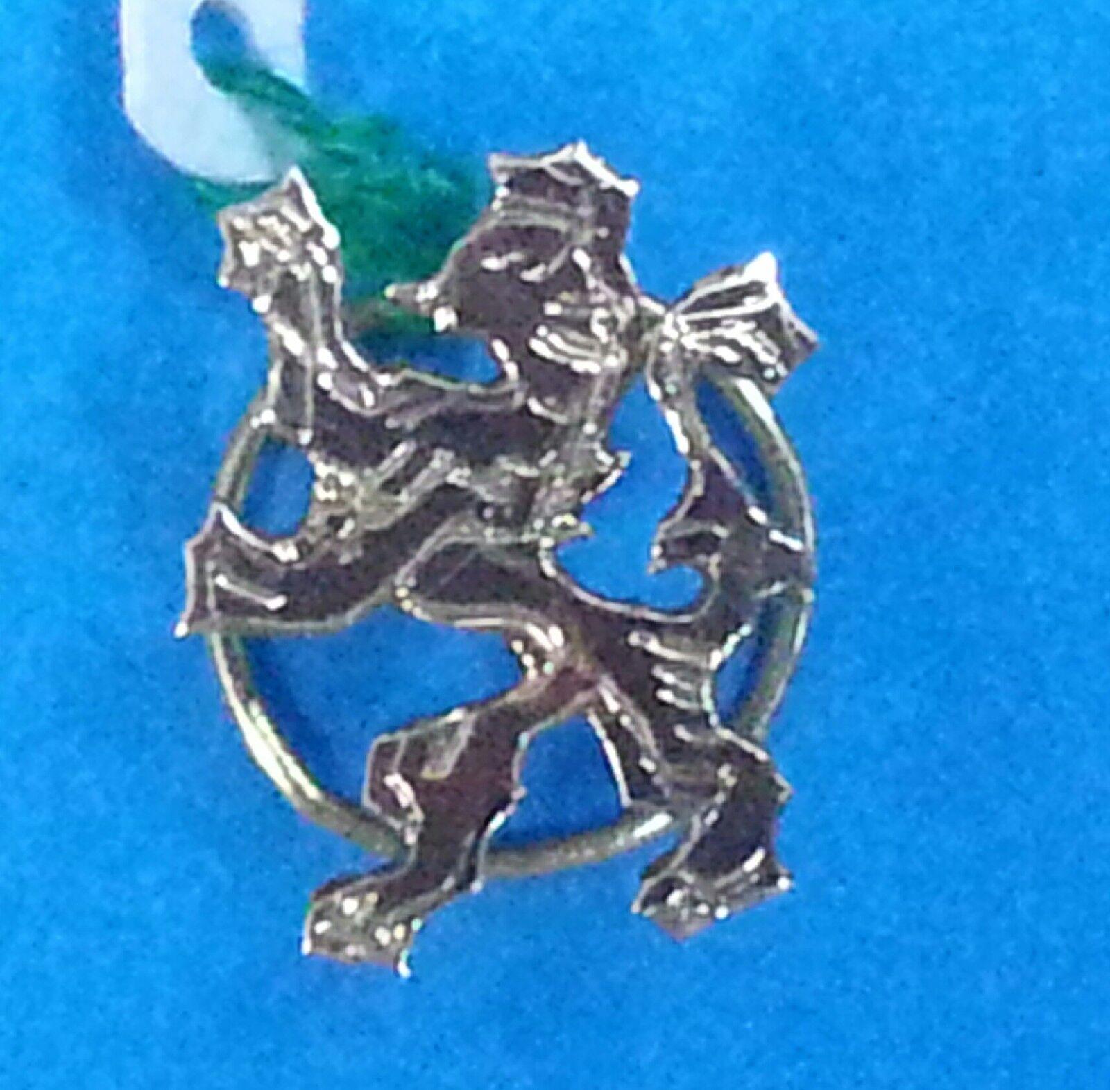 Escudo de de de Solapa de la CIUDAD DE LEON. oro de 18 Ktes. MANUAL. Peso 1 00 gr. 5084b5