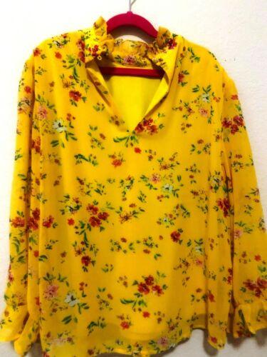 Yellow flowery long-sleeve blouse