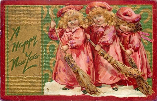 new yearbrundage girls in pink sweeping snowhay broomsred gold