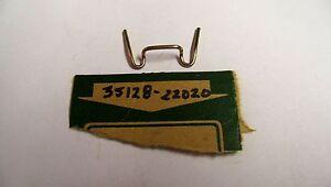 NOS OEM Suzuki HeadLamp Unit Spring 1984-1986 ALT185SE 35128-22020