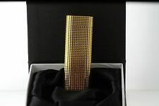 MUST DE CARTIER PLAQUE OR G LIGHTER GOLD PLATED WITH A POLISHED PYRAMID TEXTURE