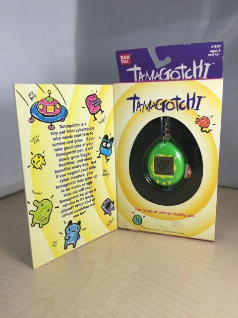 Used Bandai Original TamaGotchi Green & Yellow 1996-1997 English