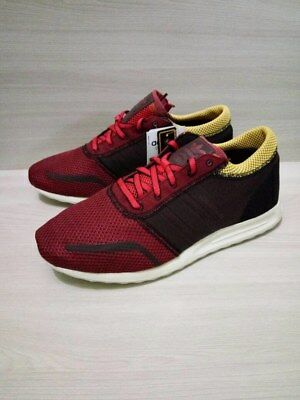 red and black adidas trainers