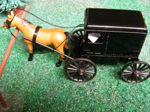 NEW TAN HORSE AND BLACK AMISH BUGGY.