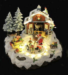 Weihnachtliche-Winterszene-mit-Rentierstall-LED-Beleuchtung-Musik