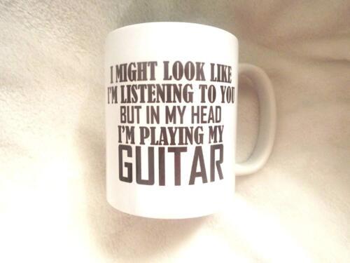 je joue au gutaiur 11 Oz Je pourrait ressembler j/'écoute mais dans ma tête environ 311.84 g Mug