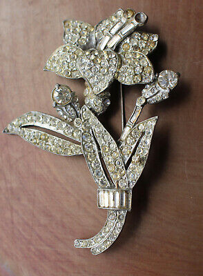 Unsigned silver tone flower brooch with rhinestones