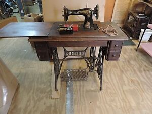antique singer sewing machine cabinet pictures