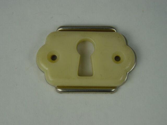Schlüssellochblende, Schlüssellochbeschlag 50er Jahre Metall + Kunststoff.