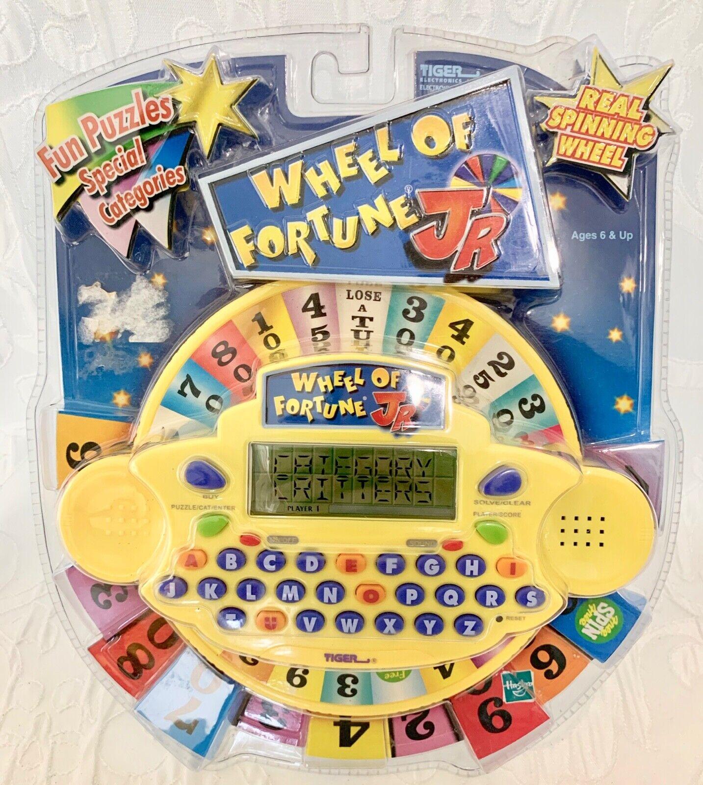 ordenar ahora Vintage Tigre Marca Rueda de la fortuna Jr. juego juego juego electrónico de mano Año. 2000  nuevo   Esperando por ti