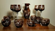 Vintage bohemian maroon/ruby crystal cut to clear wine goblets and pitcher.