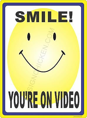 "SMILE YOUR ON VIDEO - HAPPY FACE - 9"" X 12"" NEW IN PACKAGE ALUMINUM SIGN"