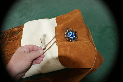 Beautiful fur in beaver bag dbl felt cow leather strap flap n feathered rosette.