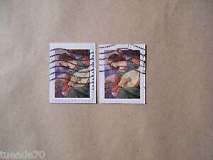 2-Briefmarken-Weihnachten-Engel-mit-Laute-USA-2010