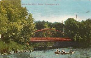 Oconomowoc-WI-Three-Men-in-a-Rowboat-Below-Red-N-Main-St-Bridge-1908-Postcard-pc
