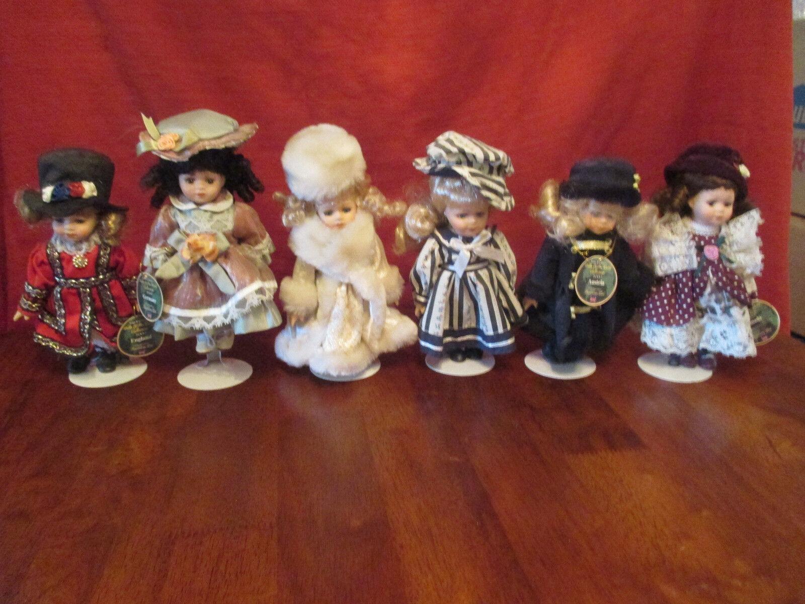 Set of 6 Barbara Lee 2000 Porcelain Dolls.. 1 missing tag..no box