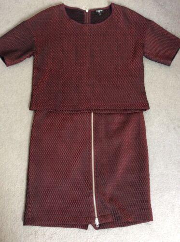 e con tubino una zip parte Gonna volta rossa indossata superiore abbinata nera a nYqwaaOH