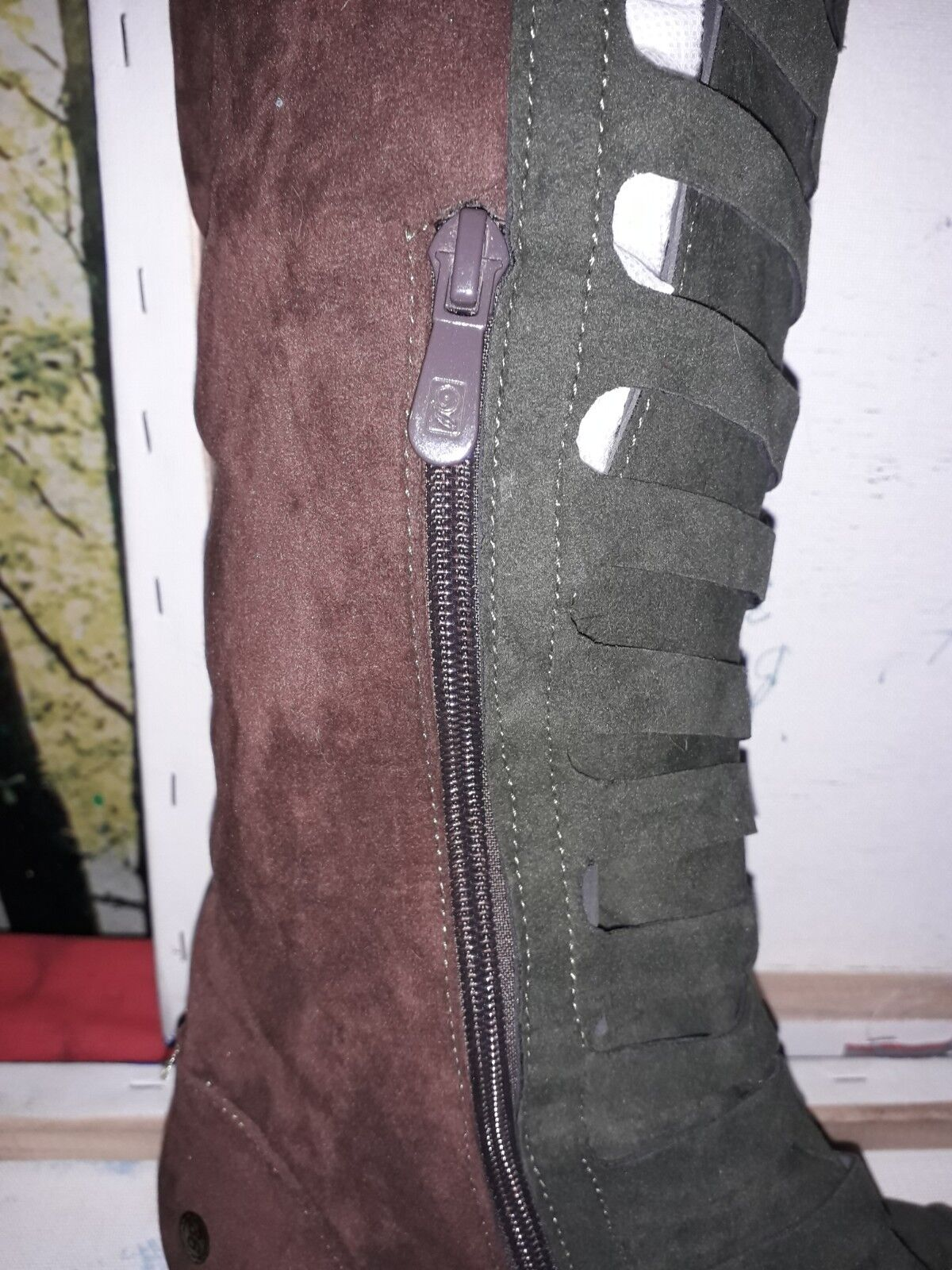 Ladies swade knee length brown and green boots.
