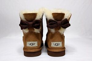 Image is loading UGG-MINI-BRIGETTE-KNIT-BOW-CHESTNUT-SHEEPSKIN-BOOTS-