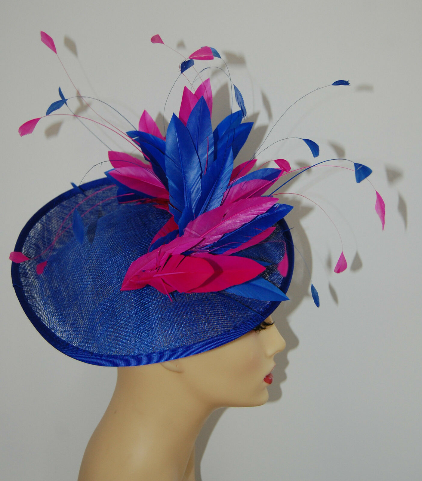 SAPPHIRE BLUE FASCINATOR WITH SAPPHIRE & CERISE FEATHER NO RETURN MADE TO ORDER